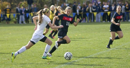 """Philadelphia, PA, United States, November 9, 2019:  Young female student athletes participate in a soccer match as part of the annual PC/GA Day sports event. The boys and girls soccer matches are part of an annual long standing inter-scholar sports competition between William Penn Charter School and Germantown Academy.  Part of the PC/GA Day is the annual football match that is described to be the """"oldest uninterrupted schoolboy football rivalry in the United States"""". The races and matches of nine sports of the 127th edition of the PC/GA day are held on the campus of William Penn Charter School in the Northwest section of Philadelphia, PA, USA on November 9, 2013."""